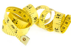 Yellow coiled tape measure on white Stock Photography