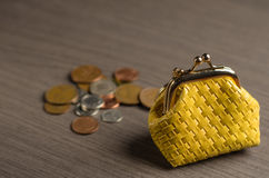 Yellow Coin Purse. Tiny yellow Coin Purse on tble Stock Photography