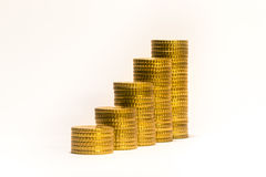Yellow coins lined up from short to tall stacks Royalty Free Stock Photography