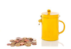 A yellow collect bus with coins. Isolated over white royalty free stock image