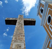 Yellow Colonial Church and Cement Cross Looking Up Stock Image