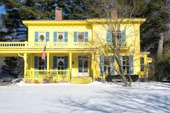 Yellow colonial house new england. A yellow historic colonial style home in Stockbridge Massachusetts on a sunny winter day stock image