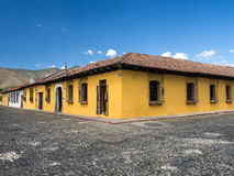 Yellow Colonial Style House. Bright yellow typical colonial style building in Antigua, Guatemala - corner perspective Royalty Free Stock Photo
