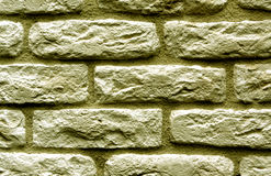 Yellow color brick wall surface. Stock Image