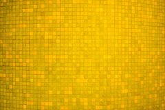 Yellow color ceramic mosaic wall background and texture. royalty free stock photo