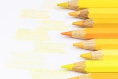 Yellow color crayons and drawn yellow samples Royalty Free Stock Photo