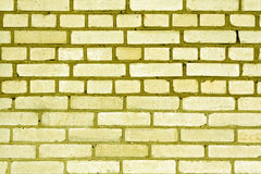 Yellow color grungy brick wall pattern. Stock Photo