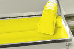 Yellow color ink roller, print shop Royalty Free Stock Photo