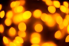 Yellow color light blurred bokeh background, unfocused. Royalty Free Stock Images