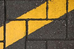 Yellow color line paint on concrete block Royalty Free Stock Photos