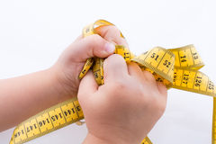 Yellow color measuring tape in hand Stock Photos