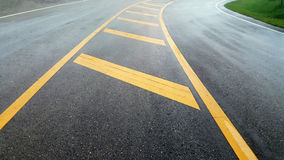 Yellow color solid line on the road and background. Photo Stock Image