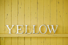 Yellow Color Word Background. A yellow painted wood background with the word yellow Stock Images
