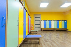 Yellow colored colourful dressing room in the kindergarten Stock Photos
