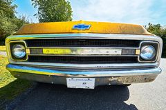 Yellow colored flat Chevrolet C-30 car of the 70`s stock photography