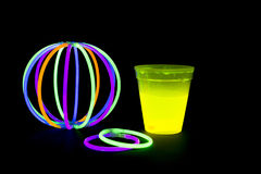 Yellow colored fluorescent glass with glow sticks lights Royalty Free Stock Photos