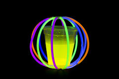 Yellow colored fluorescent glass with glow sticks lights Royalty Free Stock Images