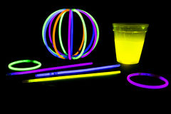 Yellow colored fluorescent glass with glow sticks lights Stock Photos