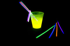 Yellow colored fluorescent glass with glow sticks lights Royalty Free Stock Photo