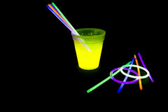 Yellow colored fluorescent glass with glow sticks lights Stock Images
