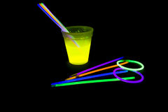 Yellow colored fluorescent glass with glow sticks lights Stock Image