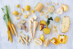 Yellow colored fruit and veg Stock Images
