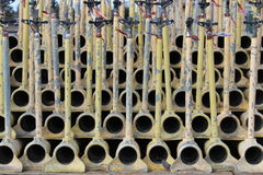 Yellow colored irrigation pipes stacked on each other.  royalty free stock image