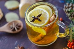 Brewed delicious herbal tea on a wooden brown background stock photo