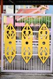 Gate with unique motifs. Yellow colored motifs on a light purple color gate at downtown Sarikei Stock Images