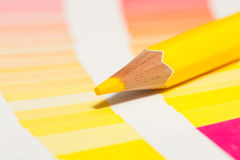 Yellow colored pencils and color chart of all colors Royalty Free Stock Photography