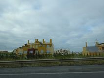 Yellow colour exteriors outside Cascais, Portugal. Picturesque bright Yellow colour building exteriors spread out on the highway outside Cascais, Portugal on the royalty free stock photos