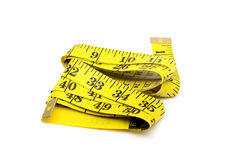 Yellow colour measureing tape on white background Royalty Free Stock Photo