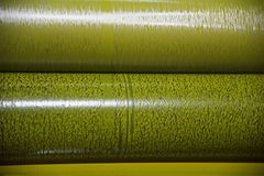 Yellow colour rolls of a printing machine. Metallic yellow colours rolls of a printing equipment isolated object unique photo royalty free stock photo