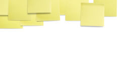 Yellow coloured paper sticky notes. A set of office/work related yellow coloured paper sticky notes. Isolated on white background Stock Image