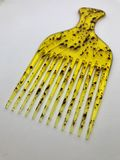 Yellow comb. Dotted yellow comb for salon Stock Photography