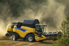 A yellow combine. Harvester working in a wheat field Royalty Free Stock Image