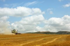 Yellow combine harvester Royalty Free Stock Photos