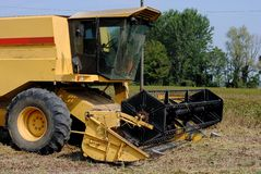 Yellow combine harvester. In a soy field Stock Photography