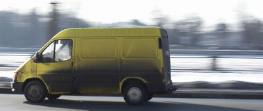 Yellow commercial van on the road driving fast Royalty Free Stock Photography