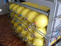 Yellow compressed natural gas cylinders. A photo of Yellow compressed natural gas cylinders stock images