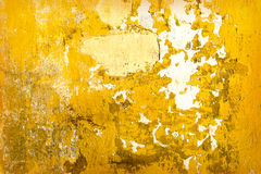 Yellow concrete cracked wall texture Stock Images