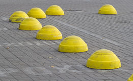 Yellow concrete hemispheres Stock Photos