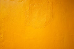 Yellow concrete wall. Closeup for background Stock Photography