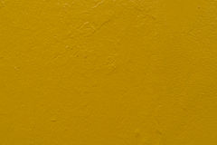 Yellow concrete wall Stock Images