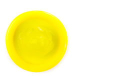 Yellow condom. From topview on white background Stock Photography