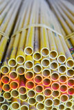 Yellow conduits. These conduits are used for electrical construction stock images