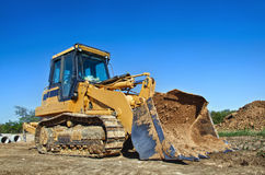Yellow construction bulldozer Stock Images