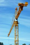 Yellow construction crane Stock Images