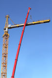Yellow construction crane during assembly using a mobile crane. Stock Photography