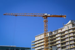 Yellow construction crane Stock Photo